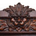 Intricate Carved Oak China Cabinet with Face