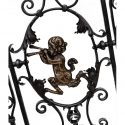 Pair of Finely Crafted Interior Iron Gates, with Brass Pan Figures