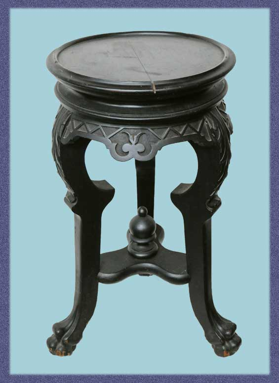Small Ebonized Stand, with Carved Legs